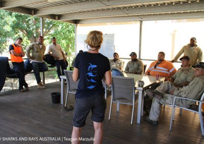 Barbara explains our research and our methods to the Gangalidda-Garawa Rangers of the Carpentaria Land Council Aboriginal Corporation. A sawfish forms part of this groups' logo, indicating the traditional importance of these animals in the region.